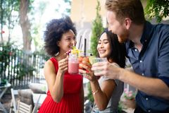 Young friends having a great time together. Group of people talking and smiling. stock images