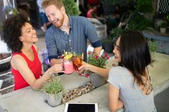 Young friends having a great time together. Group of people talking and smiling. royalty free stock photos