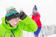 Young friends having snowball fight Stock Photos