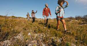 Young friends hiking in countryside Stock Photo
