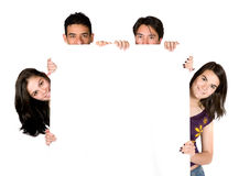 Young friends holding a white banner Royalty Free Stock Photos