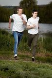 Young friends jogging Stock Images
