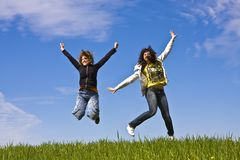Young friends jumping Stock Images