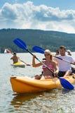 Smiling couple rowing kayak sunshine Royalty Free Stock Photos