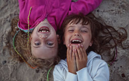 Young friends laughing while lying Stock Photography