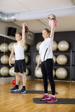 Young Friends Lifting Kettlebells In Gym Stock Photo