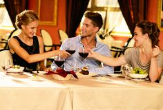 Young friends in a luxury restaurant Royalty Free Stock Photo