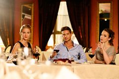 Young friends in a luxury restaurant Royalty Free Stock Images