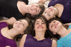 Young friends lying together Stock Photography