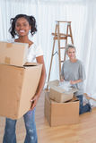 Young friends moving into new home Stock Photos