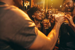 Young friends at nightclub having party Royalty Free Stock Images