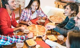 Free Young Friends On Genuine Laugh While Eating Pizza At Home On Family Reunion - Friendship Concept With Happy People Stock Photography - 174136852