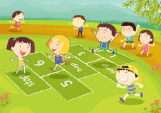 Young friends playing hopscotch. Ground of friends playing hopscotch in the park Stock Images