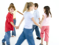 Young friends playing ring around the rosies royalty free stock photography