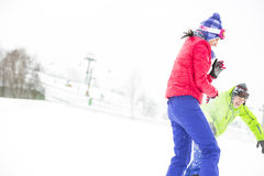 Young friends playing in snow Royalty Free Stock Photo