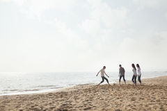 Young Friends Playing Soccer on the Beach Royalty Free Stock Images