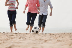 Young Friends Playing Soccer on the Beach Royalty Free Stock Photos
