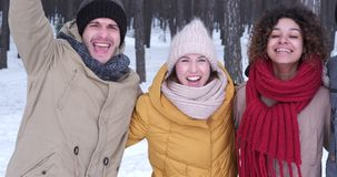 Young friends posing in warm clothing stock footage