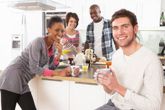 Young Friends Preparing Breakfast In Kitchen Royalty Free Stock Photos