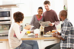 Young Friends Preparing Breakfast In Kitchen Stock Photos