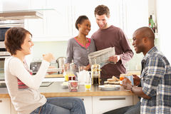 Young Friends Preparing Breakfast In Kitchen Stock Image
