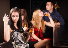Young friends relaxing in a bar Stock Images