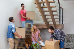 Young friends relocating in new house Stock Photo