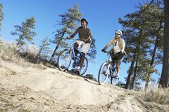 Young Friends Riding Bicycle Royalty Free Stock Images