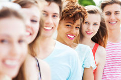 Young friends in a row smiling royalty free stock images