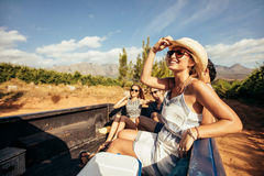 Young friends sitting in a pickup truck Royalty Free Stock Photos