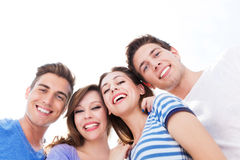 Young friends smiling Stock Photo