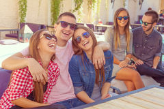 Young friends smiling and having fun Stock Images