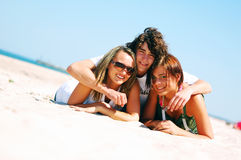 Young friends on the summer beach Royalty Free Stock Photo