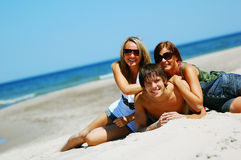 Young friends on the summer beach Royalty Free Stock Photography