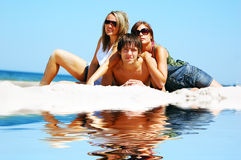 Young friends on the summer beach Stock Image