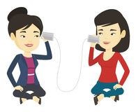 Young friends talking through tin phone. Royalty Free Stock Images