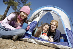 Young Friends By Tent At Campsite Stock Photography