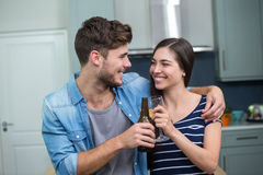 Young friends toasting drinks at home Stock Photos