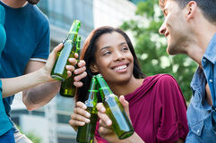 Young friends toasting outdoor Stock Photo