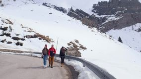 Young friends tourist walking on the road in Dolomites stock video