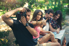Young friends tourists with map Royalty Free Stock Image