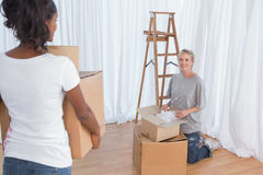 Young friends unpacking in their new home Royalty Free Stock Image