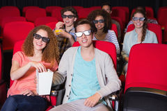 Young friends watching a 3d film Stock Photos