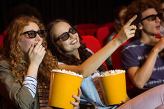 Young friends watching a 3d film Stock Image