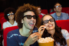 Young friends watching a 3d film Royalty Free Stock Photo