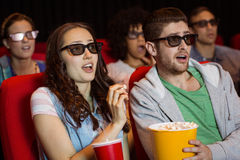 Young friends watching a 3d film Royalty Free Stock Images