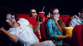 Young friends watching a 3d film Royalty Free Stock Photography