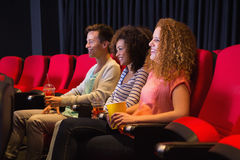Young friends watching a film Royalty Free Stock Image