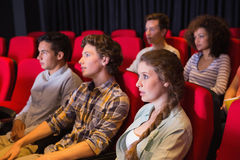 Young friends watching a film Royalty Free Stock Images