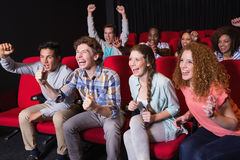 Young friends watching a film Stock Photography